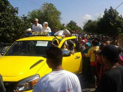 Pasangan DINDA saat konvoi di kecamatan Woha. Foto: Noval