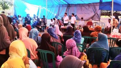 Pasangan SYUKUR saat memberikan sambutan di hadapan Rakyat Desa Lambu. Foto: Bin