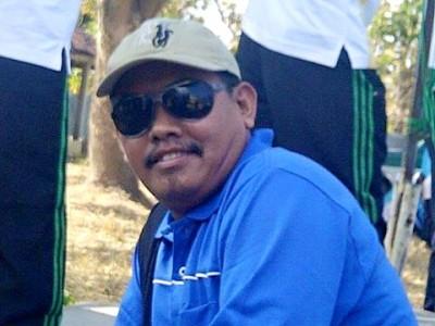 Guru pembina Olimpiade Bahasa Inggris SMPN 3 Madapangga Nukman HMT