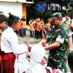 Kodim 1608 Bantu Seragam Sekolah untuk Siswa Korban Banjir