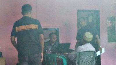 Kepala Dinas DPMDes Andi Sirajudin di ruangan Tipiter Polres Bima Kota