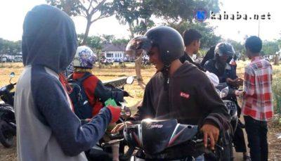 Jadi Tukang Parkir di Lokasi Tes CPNS, Tiap Hari Pemuda Sondosia Raup Uang Jutaan Rupiah