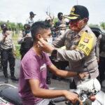 TNI-POLRI Bersama PSMTI Bagikan 1.000 Masker Untuk Pengguna Jalan