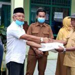 Sumbangsih Kemanusiaan, Calon Bupati Bima H Arifin Bagikan APD di Puskesmas